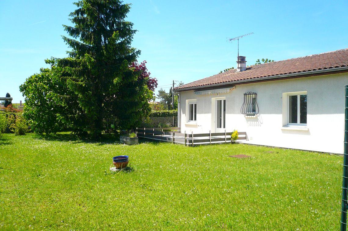 Jardin de cette maison avec 3 chambres