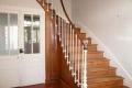 Côté jardin, la maison orientée sud-ouest propose une belle surface habitable d'environ 209 m², dont un rez-de-chaussée comprenant :
